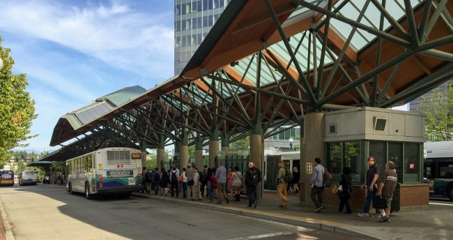 Riders wait to board ST Express buses at Bellevue's busy downtown transit center
