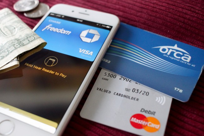 $2.50 in cash, iPhone with Apple Pay, ORCA card, pre-paid debit MasterCard