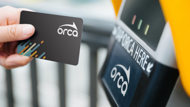 Next generation ORCA card being tapped on a reader with new logo