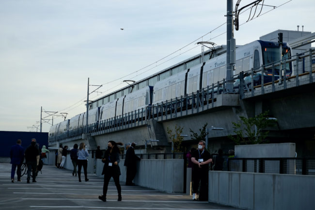 4-car new train at platform viewed from garage roof