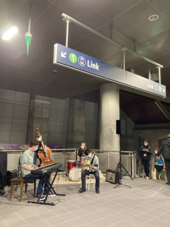 band performs music in station mezzanine