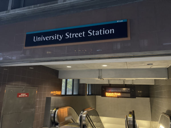 Sign marking entrance to University Street Station. Electronic sign displaying University Street name.